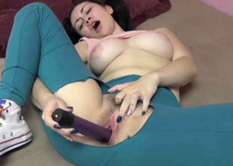 Lenna does a toy in her torn leggings